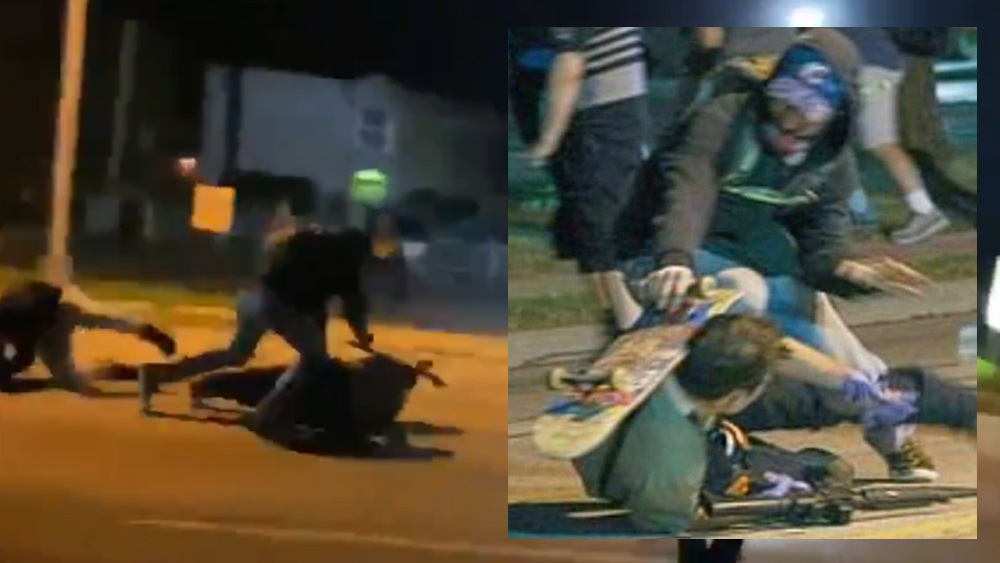 Image: FIGHT for your LIFE: Stunning video shows moment armed security man had to shoot multiple rioters from the ground or be beaten to death by Black Lives Matter thugs